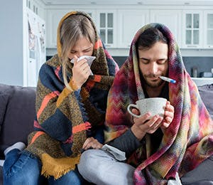 A couple with flu symptoms and fever.