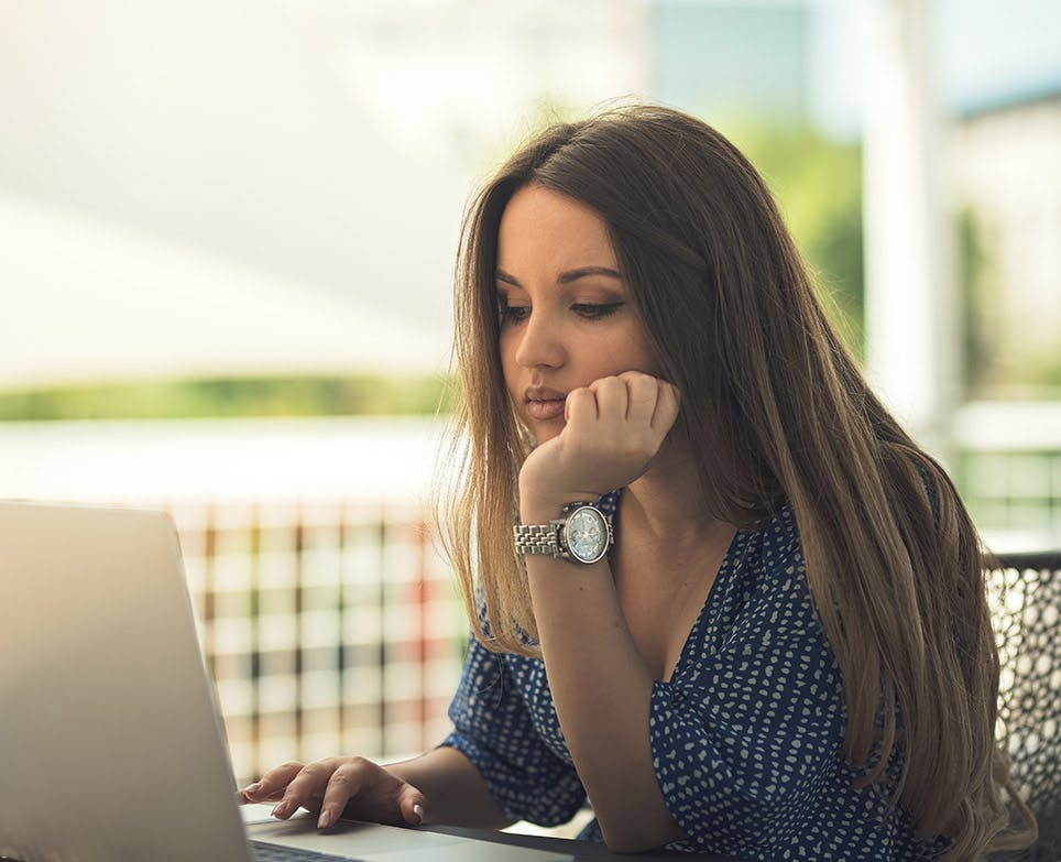 Woman working in front of the laptop.