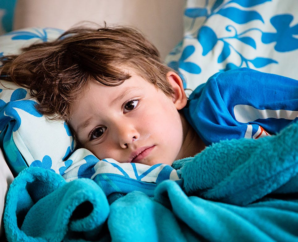 Child with flu symptoms.