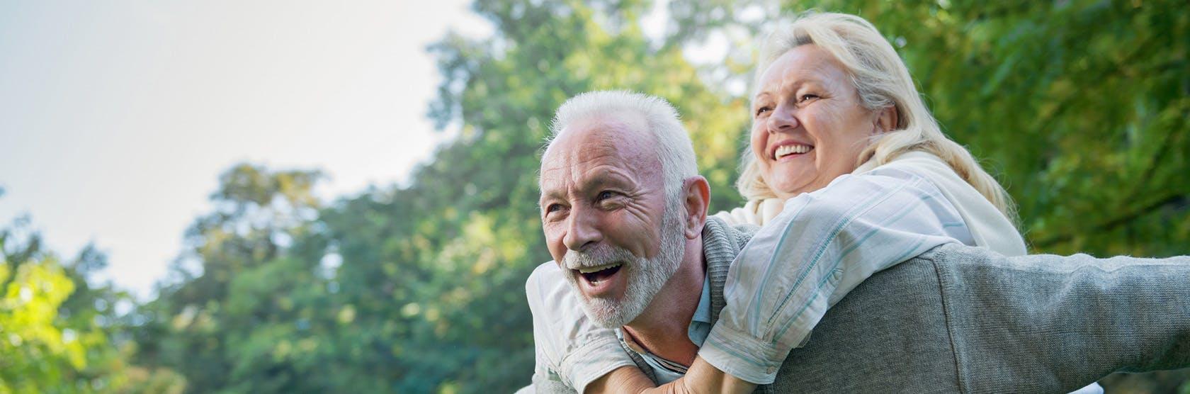 Elderly couple piggy backing