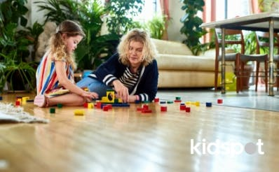 Mum and kid playing with blocks on the floor