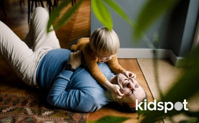 Dad and his kid playing on the floor