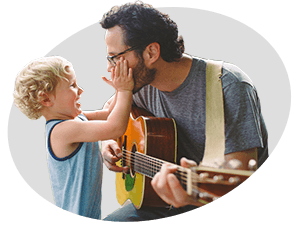 Father Playing Guitar For His Son