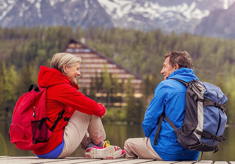 Senior Hikers Couple During The Walk Round The Tarn In Beautiful Mountain Hills