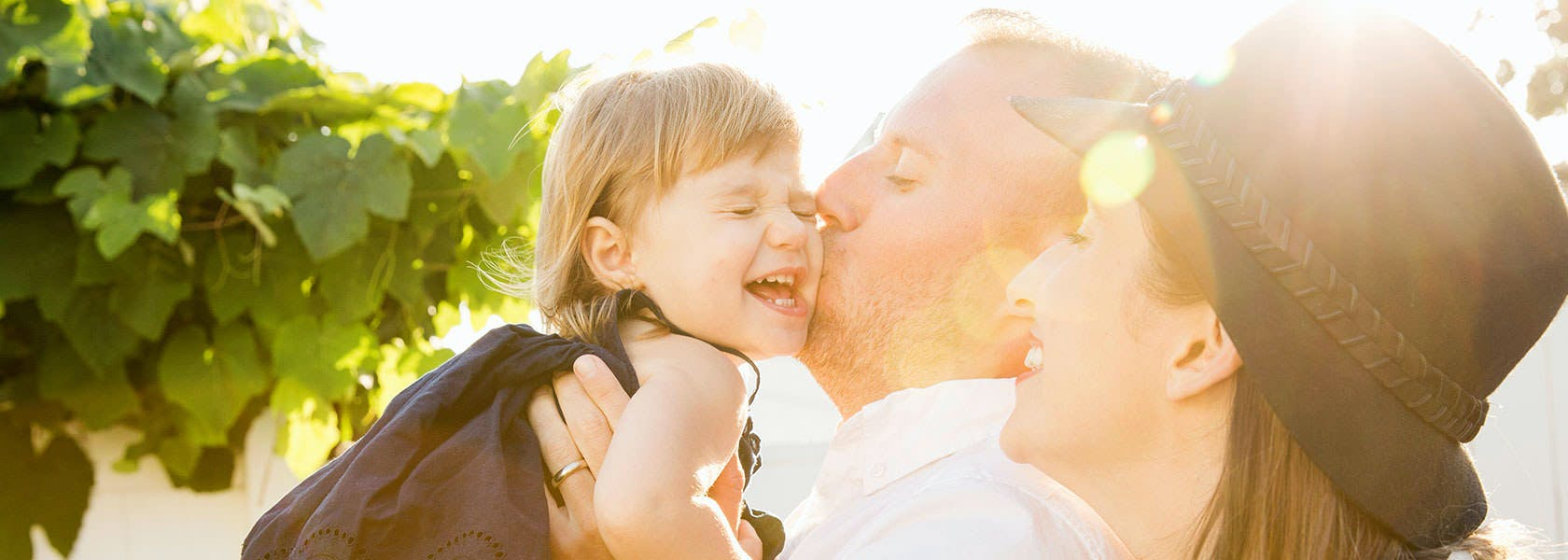 Father Kissing Toddler Daughter