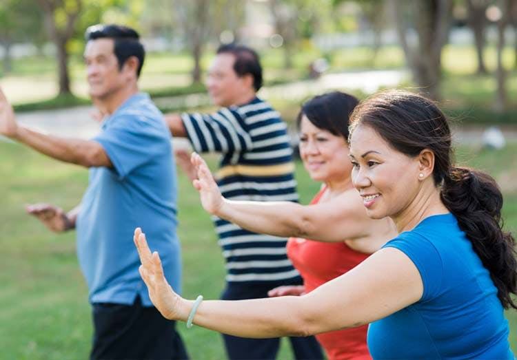Group of seniors exercising outdoors