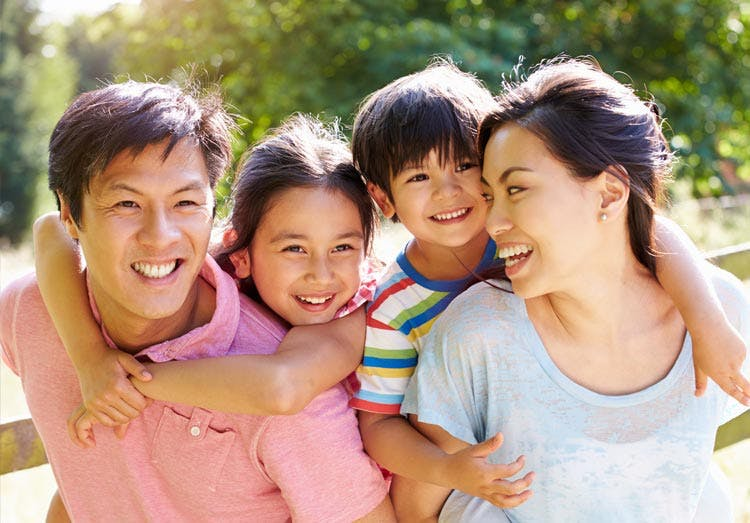 Happy Family Laughing Together
