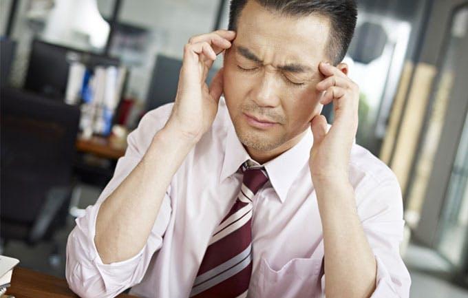 Office worker experiencing headache