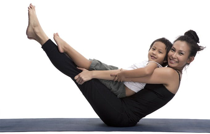 Mother and son in yoga pose