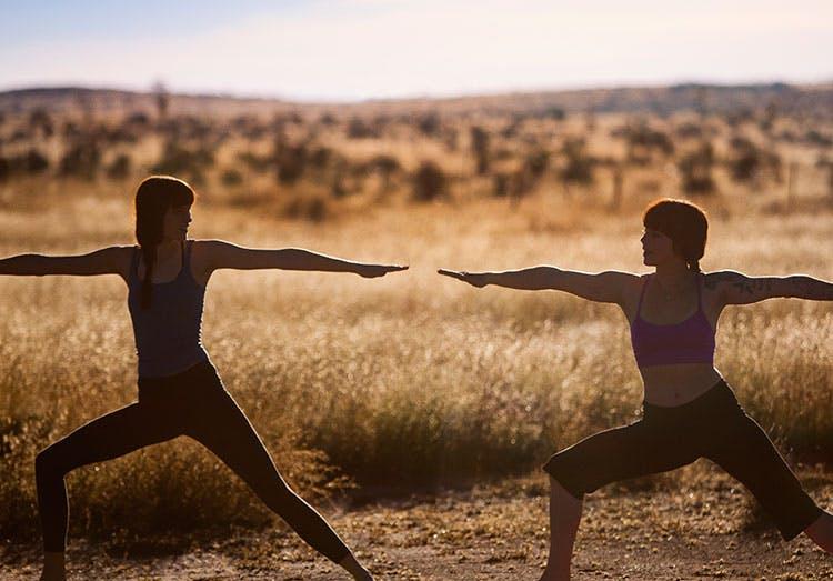 Women In Warrior Poses in Field