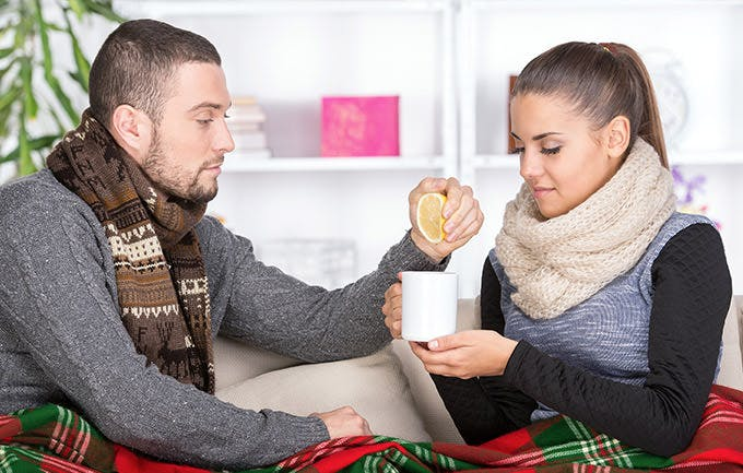 Woman Is Suffering From Cold The Boy Brought Tea With Lemon