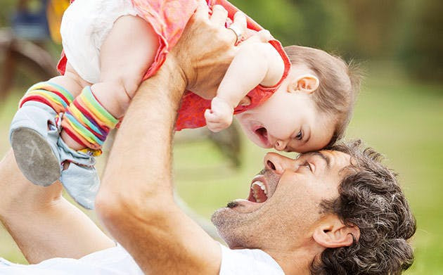 Father Playing With His Daughter In Park