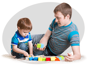 Dad With His Son Play Together At Home