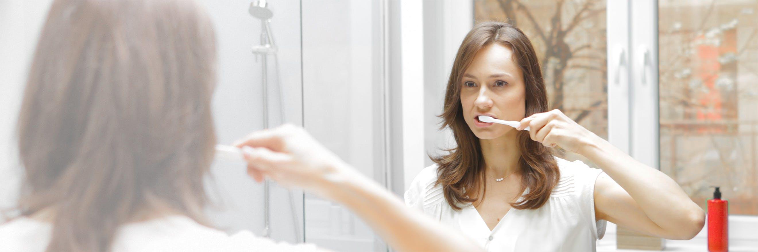 Woman brushing her teeth