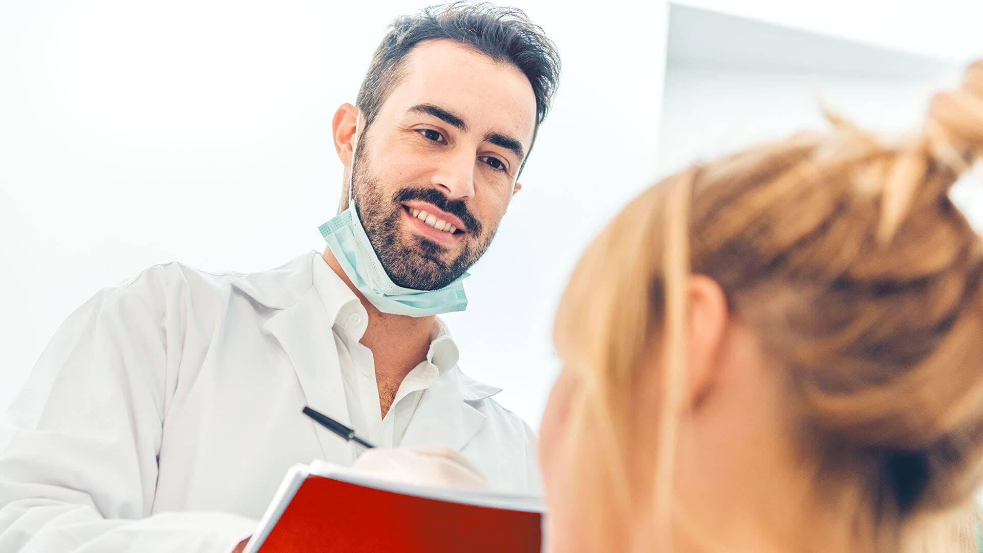 Dentist advising a patient