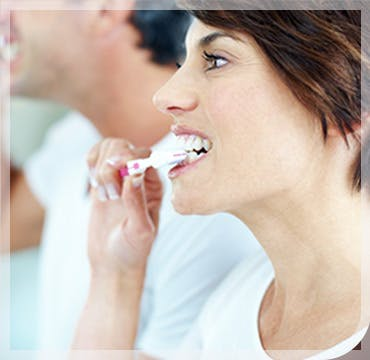 Couple Brushing Teeth Treat Gum Disease parodontax