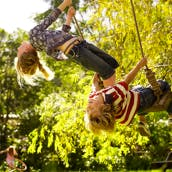 Children playing on swing ropes