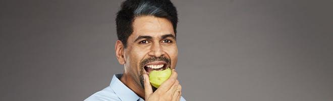 man enjoying difficult to eat food