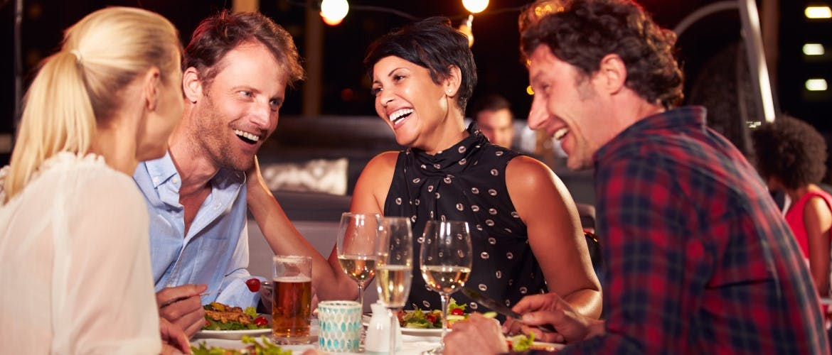 woman elaughing with friends