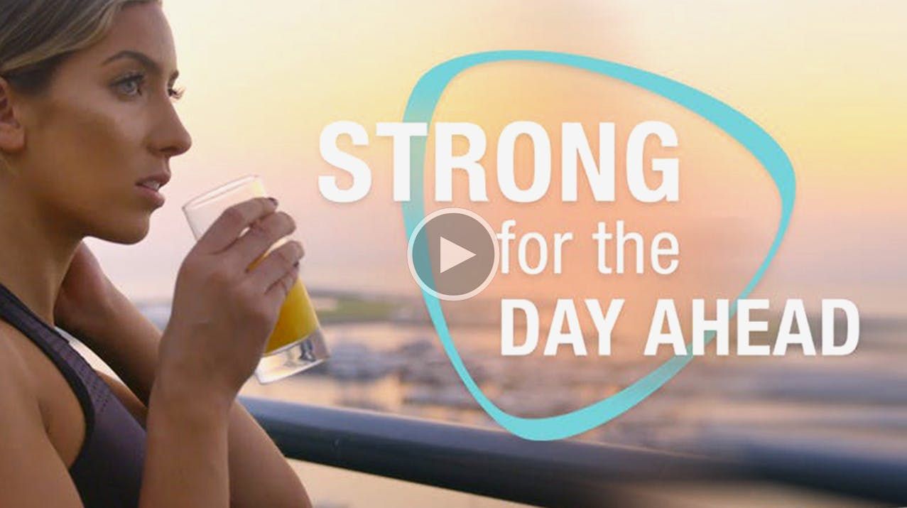 Lili Sabri Holding A Glass Of Juice Getting Strong For The Day Ahead