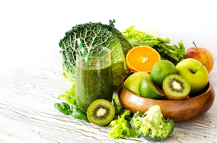 Bowl of Acidic Fruits and Green Smoothie