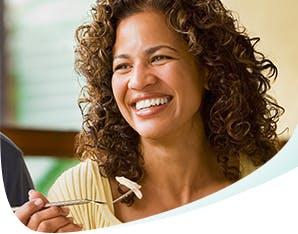 Smiling Woman Enjoying a Meal