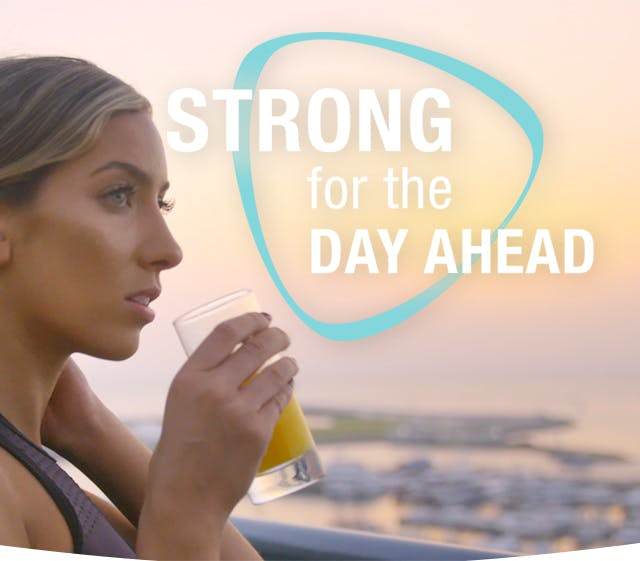Lilly Sabri Holding A Glass Of Juice Getting Strong For The Day Ahead