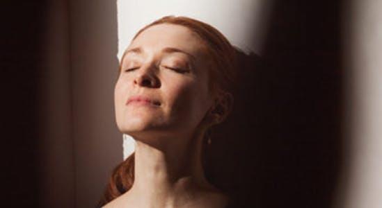 Calm woman taking a deep breath
