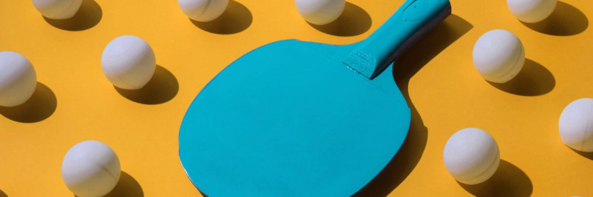 Ping pong paddle amongst ping pong balls