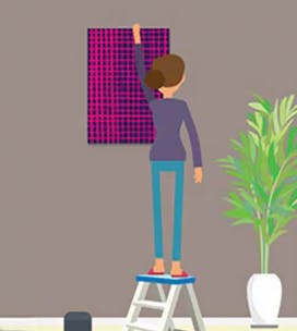 Illustration of a woman hanging a picture on the wall.
