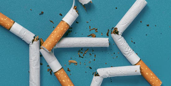5 broken cigarettes in a pile