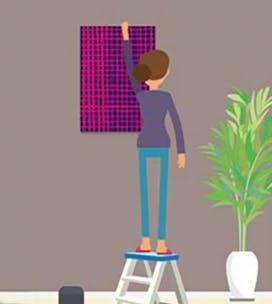 Illustration d'une femme suspendant un cadre au mur.