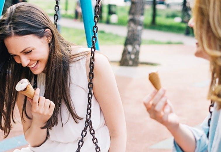 Women with sensitive teeth eating ice cream