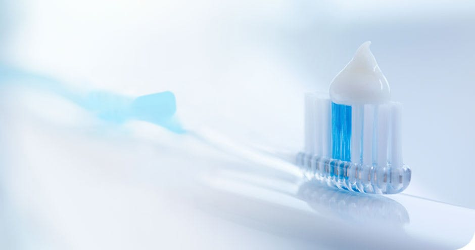 Information promoting brushing teeth daily with a soft-bristled toothbrush and using a fluoride enamel toothpaste