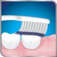 Toothbrush brushing back teeth