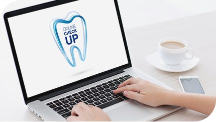 Laptop being used to access Sensodyne Online Check Up