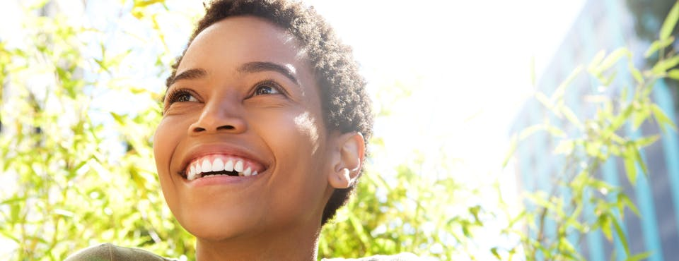 Young healthy woman smiling outdoors