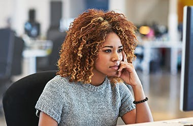 Woman in office stressed