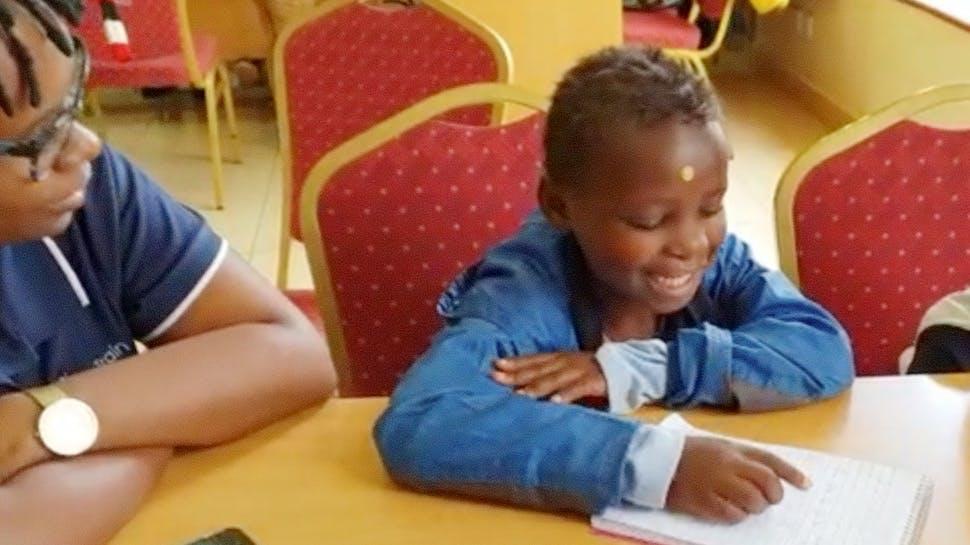 A happy child reading