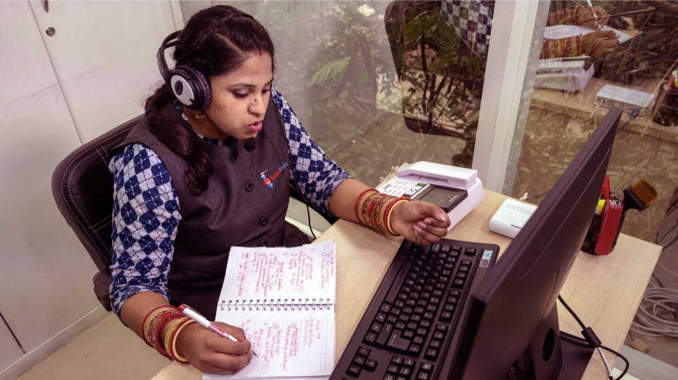 A woman talking on a computer headset