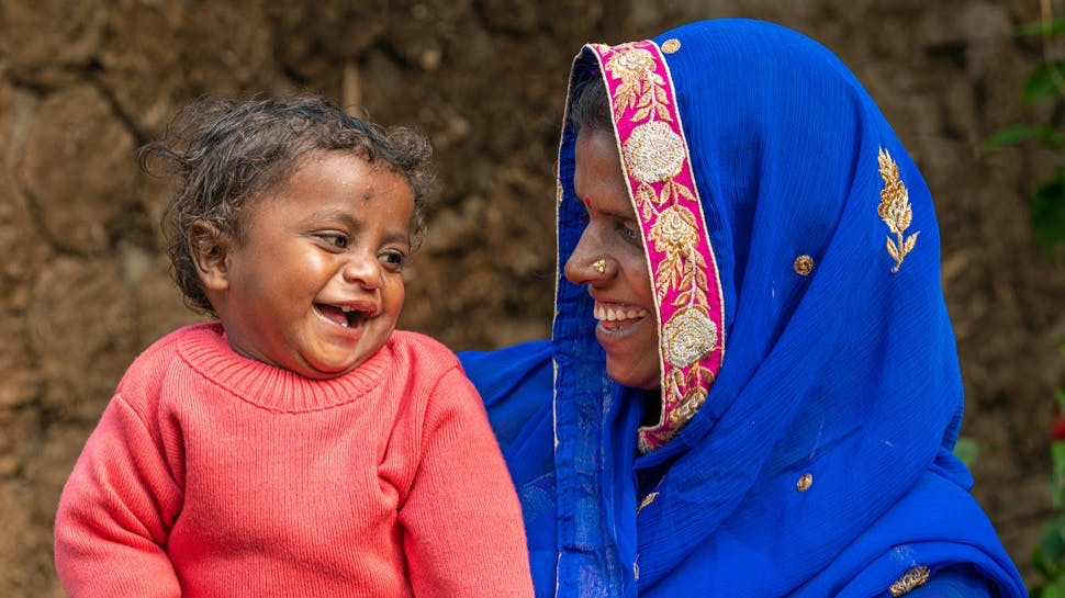 A woman and a baby smiling