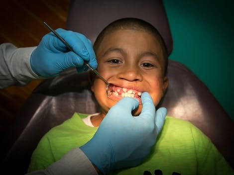 A child with cleft palate having a mouth inspection