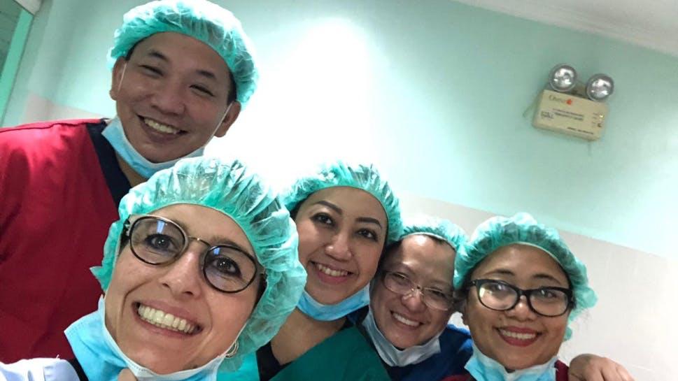 A medical team smiling