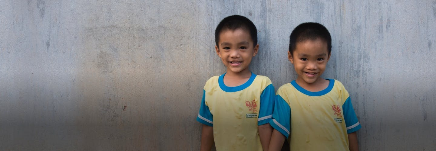 Two children post cleft surgery, smiling