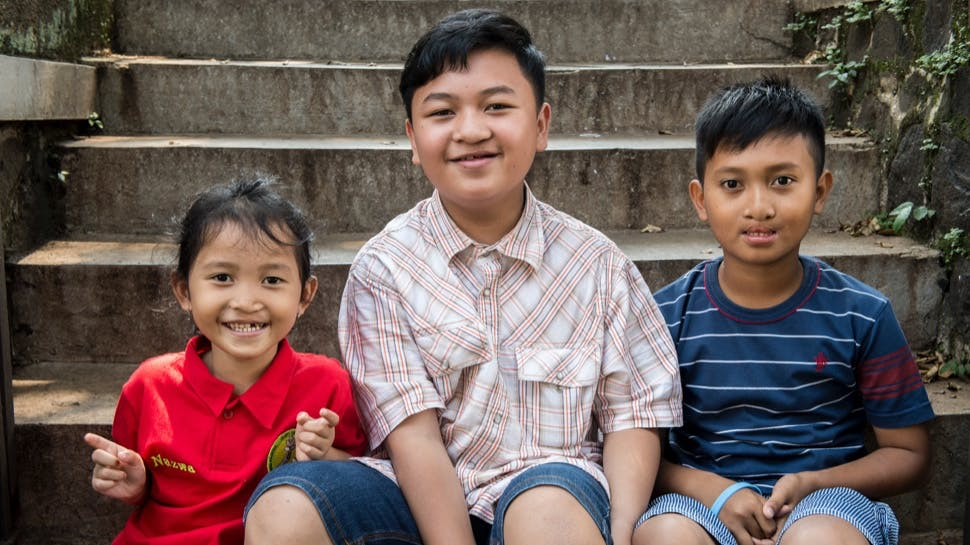 Three children post cleft surgery, smiling