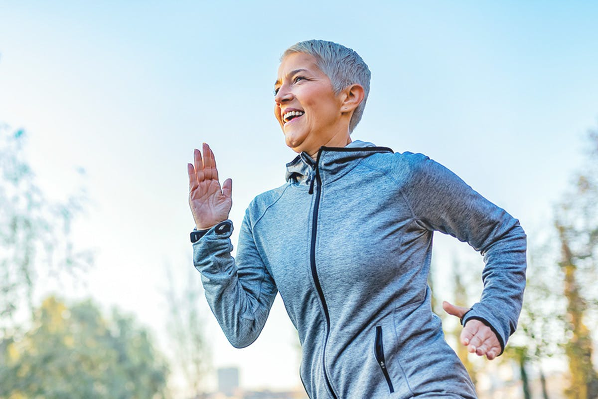 Woman running happily
