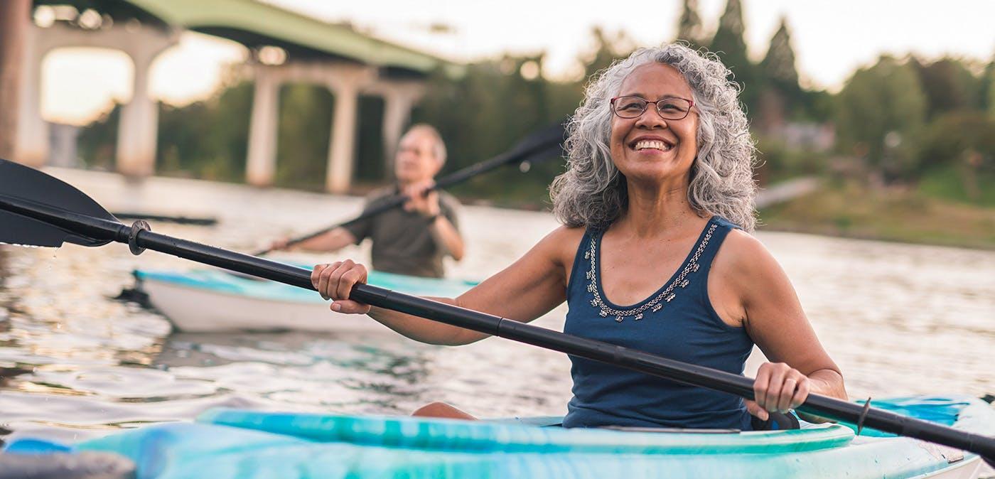 Woman smiling in a kayak