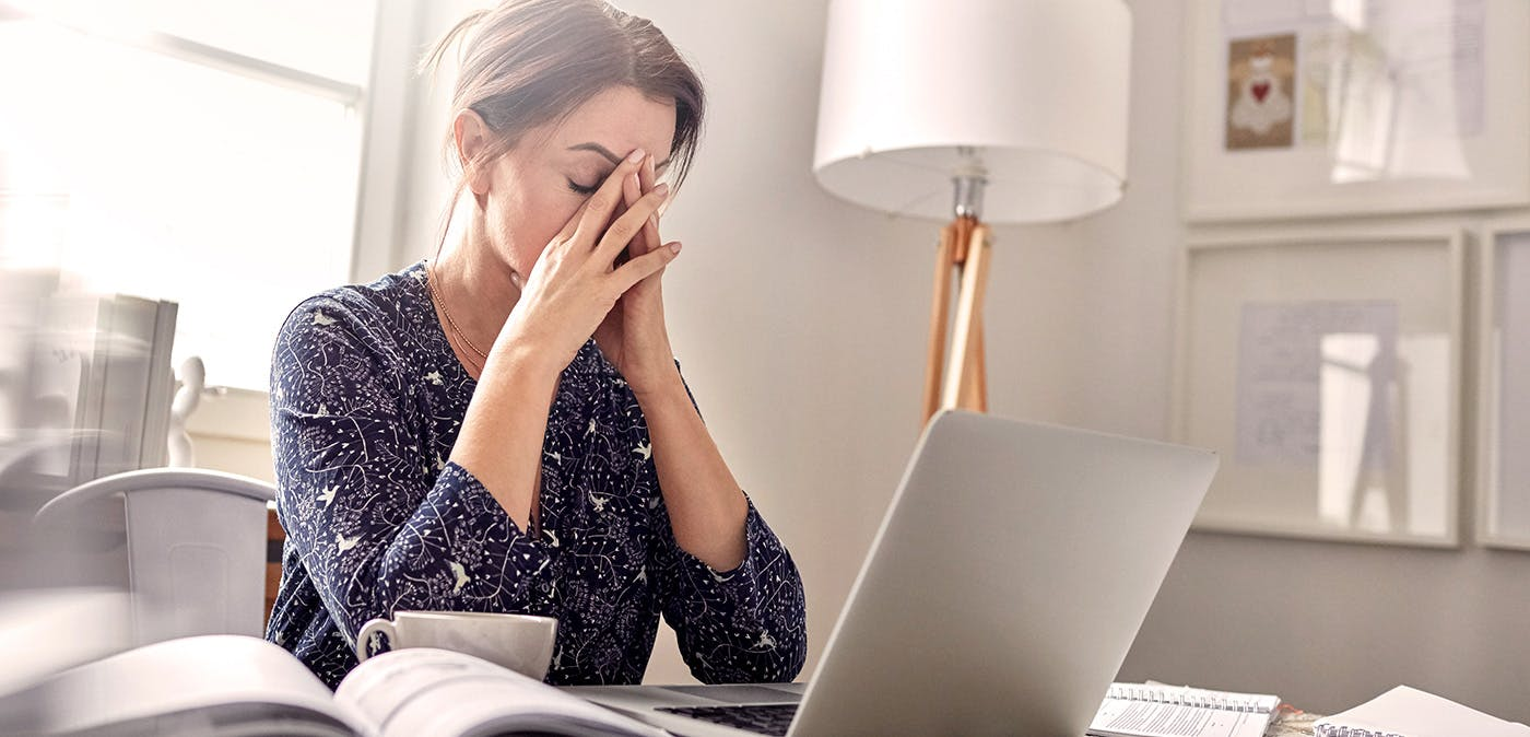 Stressed woman sitting at computer