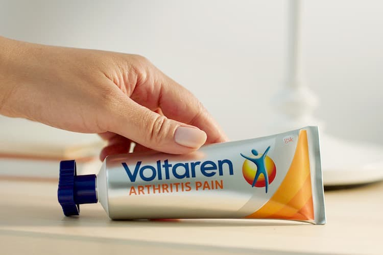 Hand holding Voltaren product