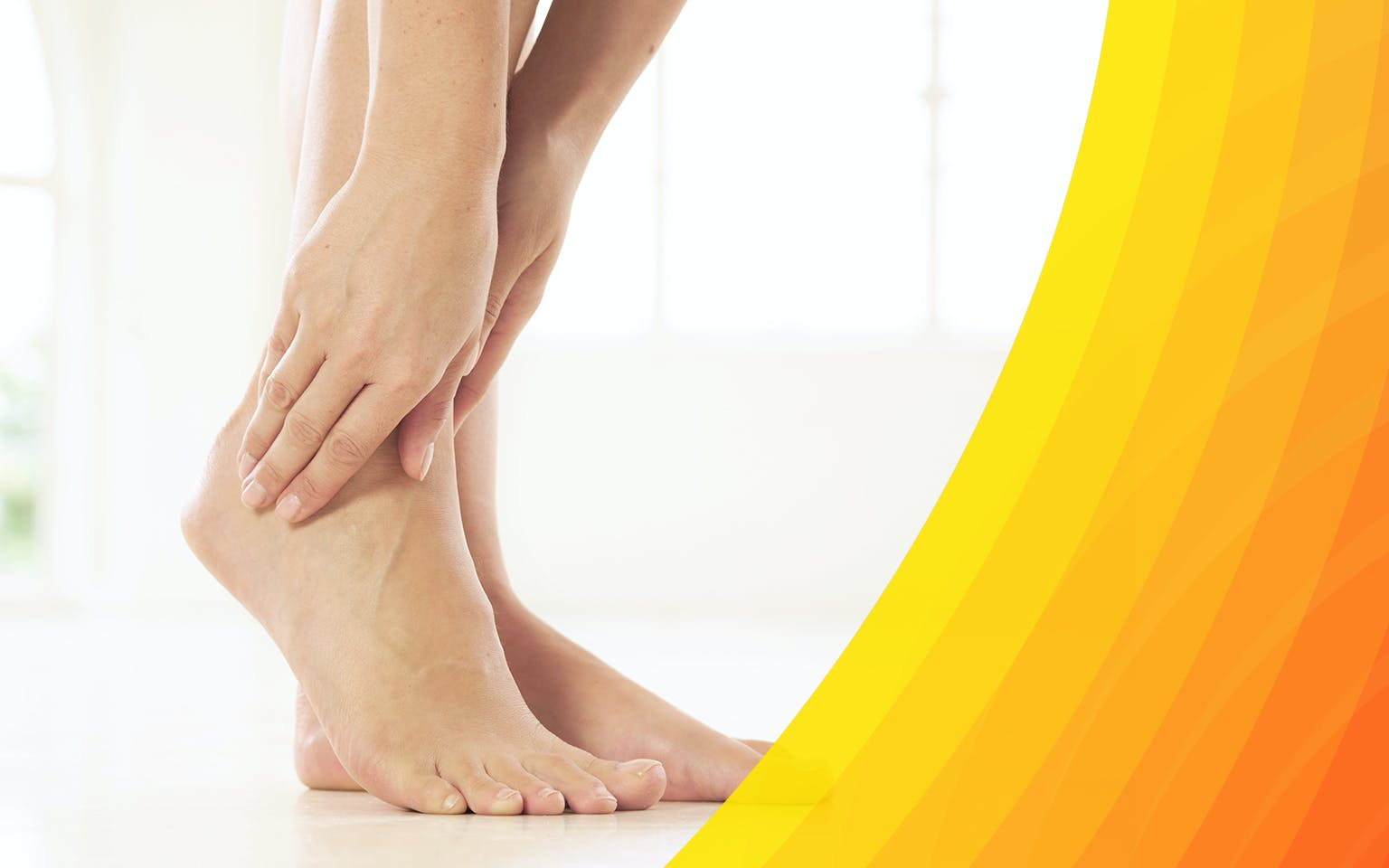 Woman's hand holding her foot because of ankle pain